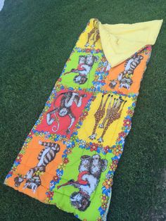 Vintage Yellow and Orange Sleeping Bag with Lots of Animals