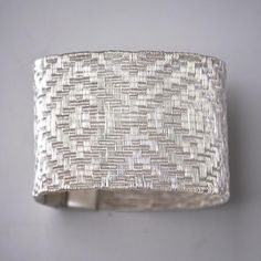 """Bracelet   Lilia Breyter.  """"Colección Texturas"""".  With refined strands of fine silver she obtains different textures, soft as silk and resistant and permanent as the noble metal she weaves.   http://www.platatextil.com.ar/en/colecciones.html"""