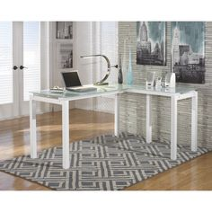 This gorgeous home office desk features a tempered frosted glass top and welded metal legs with a white powder coat finish. Center your home office around this durable, metro modern, L-shaped desk.