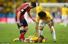Concern: Colombian playmaker James Rodrigues shows sympathy to his opposite number...