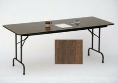 """High Pressure Folding Tables with 3/4"""" Core Size: 24 x 72, Color: Walnut by Correll, Inc.. $214.74. CF2472Px-01 Size: 24 x 72, Color: Walnut Features: -Stands at fixed height of 29''.-1 1/8'' one piece Steel Apron.-Mar-Proof plastic foot caps & edge molding.-Automatic lock-open mechanism.-Resistant to humidity and warping. Construction: -1'' 18 gauge steel pedestal legs. Dimensions: -High pressure top on 3/4'' high density particle board core with backer sheet."""