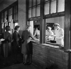 Members of the Women's Auxiliary Air Force catering section serve meals to WAAFs at the Royal Air Force depot in Uxbridge. Battle Of Britain, Royal Air Force, My Childhood Memories, Working Woman, Women In History, Middlesex England, Cabaret, Stock Pictures, World War Two
