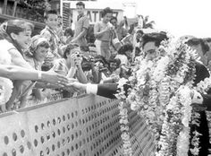 Elvis is greeted by fans and presented Leis; March 25, 1961.