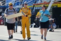 At-track photos: Saturday, Charlotte:     Saturday, May 28, 2016  -   CHARLOTTE, NC - MAY 28: Kyle Busch, driver of the No. 18 M&M's Toyota, signs an autograph during practice for the NASCAR Sprint Cup Series Coca-Cola 600 at Charlotte Motor Speedway on May 28, 2016 in Charlotte, North Carolina.