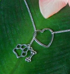 Silver Animal Lover Necklace with Heart, Paw Print, and Bone, handmade jewelry. $21.00, via Etsy.