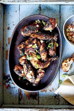 Get the recipe for peanut butter and jelly grilled chicken wings, which are sweet, savory and the best new addition to your summer grilling menu. Chicken Marinade Recipes, Pork Rib Recipes, Chicken Wing Recipes, Meat Recipes, Cooking Recipes, Cooking Chicken Wings, Grilled Chicken Wings, Grilled Meat, Pork Brisket