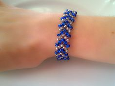 This unique bracelet is made with stunning sapphire blue silver lined glass beads, with rows of clear silver lined beads between. This bracelet is