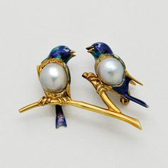 Cultured pearl, enamel and gold 'blue birds of happiness' brooch. (dupuis.ca)