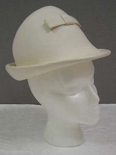 Hat   André Courrèges  (French, b. 1923)   Date: 1964   Materials: leather, cotton, synthetic   The Metropolitan Museum of Art, New York