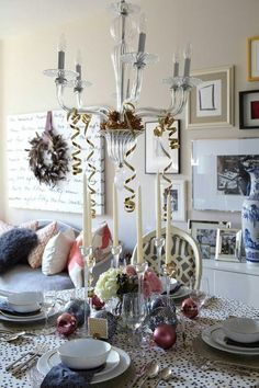 I would add tiny embellish-ments here & there...esp in the top of that GORGEOUS chandelier, just a light sprinkling of cedar or blue spruce (or both) boughs w/ berries to echo the mauve-y pinks..... i have ideas bombarding my brain! Ljb:)