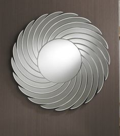 This attractive round mirror has a small central piece and a border made up of many petals flowing outwards in a spiral shape - these are made of clear bevelled glass. This flawless mirror would be a bold addition to any room   Diameter: 90cm http://www.totalmirrors.com/round-mirrors/195-round-spiral-mirror-90cm-diameter-5055157621963.html
