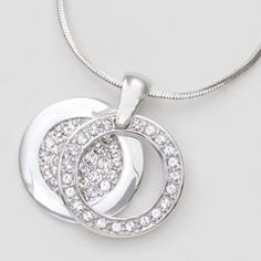 Circle Duo Necklace. An open circle rests on a pavé circle for the illusion of one.  $57