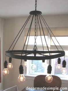 TUTORIAL: industrial rustic chandelier out of a farm plow wheel