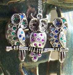 This cute necklace features a Tibetan silver Three Owl pendant, they are accented with gorgeous crystal rhinestones to give them a little sparkly character.