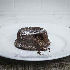 Impress your guests with these rich chocolate lava cakes from <i>Amanda Rettke of i am baker</i>.  For perfect cakes every time, check out Amanda's tips for easy removal of the cakes from the ramekins.
