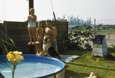 Anyone of you have one of these Dough-boy swimming pools? They were quite the rage in the late 50s-mid 60s. They let families have a swimming pool in the backyard without having to put an in-ground one in. Look --- there's an old incinerator (that white and black thing) behind them. This is a photo from out in Orange County area of Cali in 1960. It's close to where Disneyland is - you sure won't find any open land like is seen beyond the chain-link fence out there today!