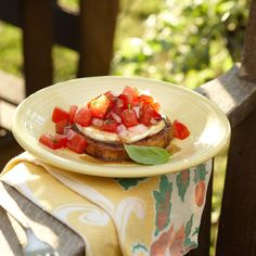 """Crispy Eggplant Bruschetta Recipe -One word describes this summer appetizer...""""wonderful""""! The crispy exterior of the tender eggplant slices and the robust taste of tomato and basil topping create a dynamic flavor duo. It's delicious served chilled or at room temperature."""