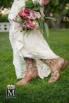 Special wedding day touches like these cowboy boots paired with beautiful pink floral bouquets are great for a outdoor rustic styled wedding. Photo captured by M Place Productions as seen in Spectacular Bride Magazine. Taken at exquisite venue The Grove in beautiful Las Vegas