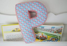 almofada letra tecido