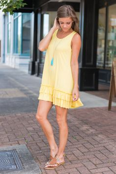 This lovely little dress is perfect for warm summer days! The jersey knit fabric is soft and bouncy and the cut is so beautifully casual! We think the ruffled hemline was the perfect addition to this tank dress!! There is no lining but it's fine since the fabric isn't sheer!
