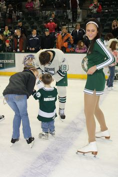 Bemidji State hockey cheerleaders skating with fans during Skate With the Beavers night.