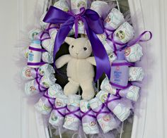 This adorable DIY Diaper Wreath is a perfect gift option for your next Baby Shower. It is not difficult to make and this post will show you each step.