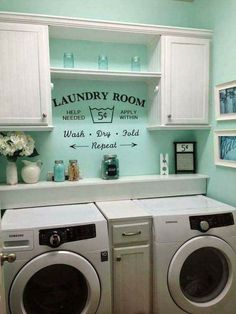 laundry room....small cabinet between machines-shelf behind machines-good color-saying on wall