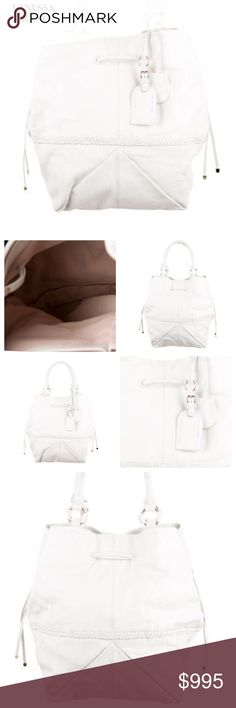 "VANESSA BRUNO WHITE TOTE LEATHER BAG Vanessa Bruno woven leather accent tote with luggage tag at shoulder strap, dual shoulder strap & magnetic snap closure at top. Color: White. Hardware: Light gold-tone. Lining: Pink Canvas. Material: Leather (minimal creasing due to nature of leather) Color: White. Approx Measurements: Shoulder Strap Drop 7"", Height 16"", Width 11.5"", Depth 10"". Condition: Excellent. Leather naturally creases with this bag for a loved in effect. Includes dust bag & tags…"