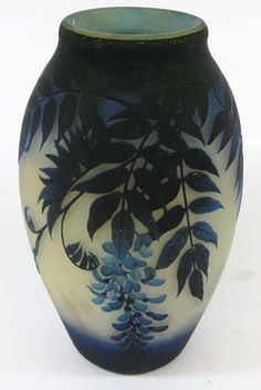 MULLER FRERES CAMEO GLASS VASE. The shaded blue to cobalt wisteria pattern against grey ground signed in cameo Muller Freres Luneville. Height 13 3/4, width 8 in. c. pre-1900.