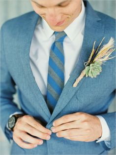 How handsome is this groom in blue?