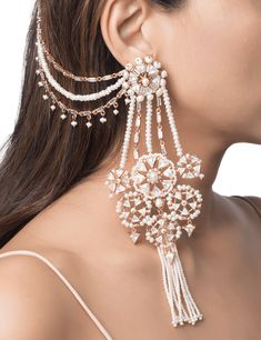 The heritage sahara earrings are handcrafted in base metal with 22 kt gold plating and feature an ornate arrangement of Swarovski cubic zirconia crystals and tiny luminous pearls. Pearl tassels and a layered sahara that hooks onto your hair add a unique a Indian Jewelry Earrings, Indian Jewelry Sets, Jewelry Design Earrings, Ear Jewelry, Bridal Jewelry Sets, Bridal Earrings, Wedding Jewelry, Gold Jewelry, Statement Jewelry