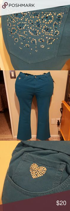 Quacker Factory rhinestone embellished knit jeans Cotton spandex knit 5 pocket jeans. The jeans have a faux fly and rhinestone button. On the coin pocket there are rhinestones in the shape of a heart and on the back pockets there are silver blue and teal rhinestones. The jeans are very stretchy and pull on with elastic at the waist. Inseam 30.5 inches. Brand new with tags and never worn. Quacker Factory Pants Boot Cut & Flare