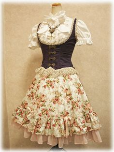 Gorgeous! So pretty look at the print and the underbust and the blouse....everything about...