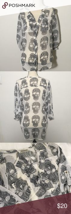 """Necessary Clothing skull hi-lo blouse White sheer top with black skulls by Necessary Clothing. There are 2 sheer breast pockets and one gold colored button on each sleeve. Size Small, measurements are Bust 38"""", Length 28"""", Sleeve 14"""". The material is 100% polyester. Excellent condition.                                                      🚭Smoke Free Home🚭 ✅Offers Welcome on All Purchases ✅Next Day Shipping 📏Measurements Taken Flat ❌Off-Posh Transactions ❌Trades Necessary Clothing Tops…"""