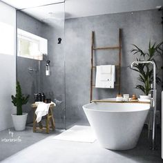 I love the concrete style walls and flooring in this bathroom. A lovely shower corner and huge stand alone bath with plenty of rustic touches. Bathroom Design Inspiration, Modern Bathroom Design, Bathroom Interior Design, Interior Paint, Bathroom Renos, Small Bathroom, Bathroom Luxury, Bathroom Styling, Cheap Home Decor