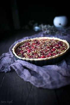 Serve this flavorful Cranberry Pecan Tart at holiday parties! It's perfect for Thanksgiving. Get the easy-to-prepare recipe from Savory Simple.