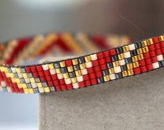 Miyuki beaded bracelet Aztec pattern with 24 carat gold plated beads - Gold plated lobster clasp Bead Loom Designs, Bead Loom Patterns, Beaded Jewelry Patterns, Bracelet Patterns, Bead Loom Bracelets, Woven Bracelets, Ankle Bracelets, Handmade Bracelets, Beaded Bracelets