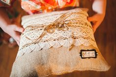 A Fun Rustic Coral and Aqua Wedding - Love the Burlap Ring Bearer Pillow in this pretty wedding!