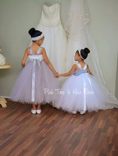 How adorable is this dress! Your little one,will be sure to grab attention is this dress, but not too much attention from the Bride! :)   This flower girl dress is fit for a princess,and a perfect addition to your special day. This dress is designed with yards and yards of high quality tulle,with handmade flowers,in shades of Gray and white..  Please choose sizing,and leave measurements for a perfect fit. This dress is made full length  ~~~~~~~~~~~~~~~~~~~~~~~~~~~