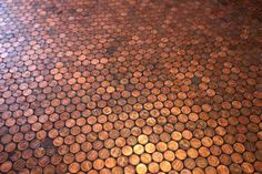 Penny Floor - the best part about this post is reading all the comments. I'm thinking an outdoor table would be so cool - maybe it would age green like copper does?!