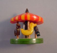 ADRIAN bakelite carousel brooch in red, butterscotch, green   -How wonderful to wear this and make everyone smilel.