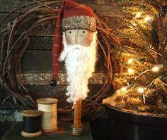 Twiggy Grapevine Wreath...grungy Santa on an old bobbin...lighted pine.
