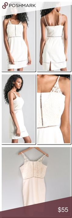 Joa Lace Bodice Dress A sexy dress featuring embellished lace crotchet inserts at the bust. Fitted throughout. Closes at the back with an invisible zipper. self 100%  cotton-Contrast 100%Polyester - Lining 100%Polyester   Cream color, dry clean only. Dresses