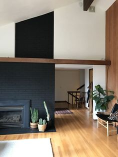 Image result for huge black brick fireplace