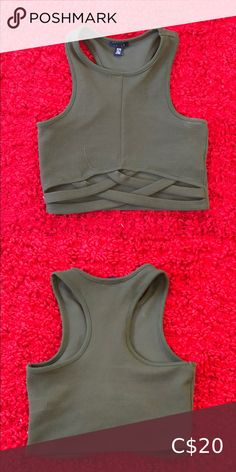 Detailed racer back crop top Forest green. Criss cross pattern on lower ribcage. Size M but fits like a size small. Worn once. Tops Crop Tops Halter Crop Top, Lace Tank, Cropped Tank Top, Long Sleeve Crop Top, Short Sleeve Blouse, Light Blue Crop Top, Blue Crop Tops, Lounge Shorts, Mini Shorts