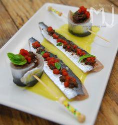 Sardinas marinadas con salsa de naranja, olivada y caviar de tomate - Marinated Sardines with Orange sauce, Tapenade and Tomato Concasse