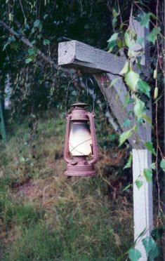 these lanterns flicker and make cricket sounds.reminds me of pirates of the carribean. Solar Garden Lanterns, Old Lanterns, Rustic Outdoor, Outdoor Decor, Old Western Towns, Fishing Chair, Old Lamps, Backyard, Patio