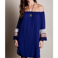 Bell Crochet Sleeve Dress Stunning color of indigo blue with crochet details on a bell sleeve. Can be worn on or off the shoulders Dresses