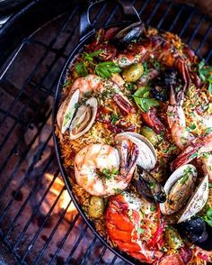 Woodfire Ecuadorian Prawn Paella. Fresh. Exotic. Gorgeous. Brilliant. Cheers! -David  Blog: http://ift.tt/1vCV6pv  #manvswild #seafood #pescatarian #paleo #crab #shrimp #prawn #fish #rice #muscles #octopus #oysters #friday #weekend #lobster #instagood #foodstagram #foodgasm #foodporn #beer #bbq #barbecue #grill #grilling #asado #beautifulcuisines #chef #feedme #notallwhowanderarelost . . . @foodnetwork @todayfood @nytfood @huffposttaste @foodgawker @foodbeast @thefeedfeed @eater @foodnetwork…