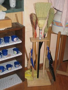 Add child-sized brooms to the dramatic play center. You might see them volunteering to sweep the sand from the sensory table! lol